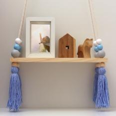 DECORATIVE WOODEN HANGING SHELF WITH BEADS AND TASSELS.